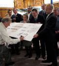 Bobby Geroulanos signs the $1 million check to School of Plato.
