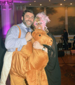 Hellenic Medical Society President Dr. George Liakeas in costume with a friend, PHOTO: ETA PRESS