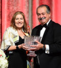 THI founder and Chairman Andrew Liveris offering the organization's highest award to Beatriz Perez, Senior Vice President and Chief Communications, Public Affairs, Sustainability and Marketing Assets Officer for The Coca-Cola Company