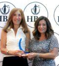 Hellenic Bar Association President Koula Alevizos Fournier (right) presents an award to Immediate Past President Vicki Pappas Karl for her service to the organization; PHOTO: HELLENIC BAR ASSOCIATION OF ILLINOIS