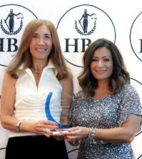 Hellenic Bar Association President Koula Alevizos Fournier (right) presents an award to Immediate Past President Vicki Pappas Karl for her service to the organization; PHOTO: HELLENIC BAR ASSOCIATION OF ILLINOIS