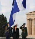 The flag being raised at the Acropolis with President Katerina Sakellaropoulou